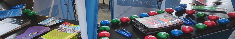 Body Positive merchandise arranged on a table