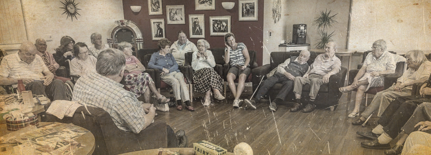 A group of people sat in a circle sharing stories