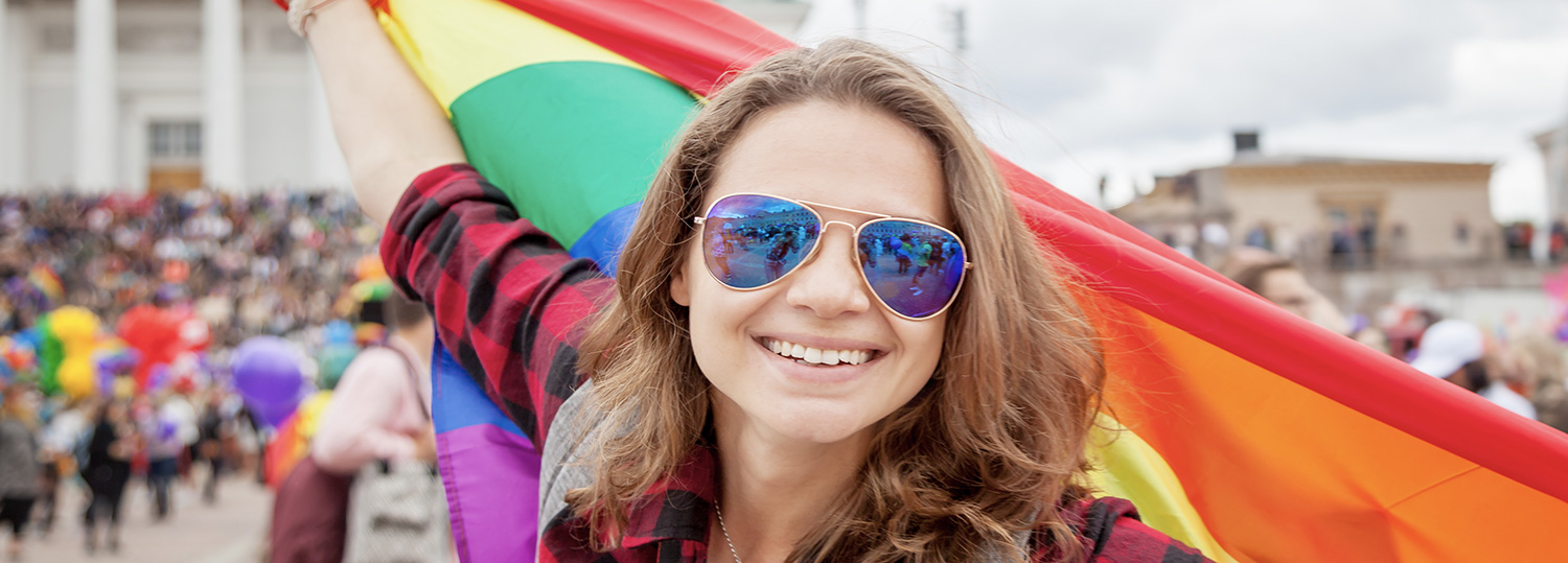 Lady holding a colourful flag